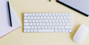 white keyboard on yellow background