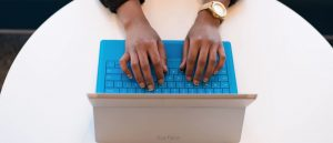 Person typing on Microsoft Surface