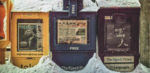 three newspaper stands