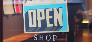 shopping open sign on door