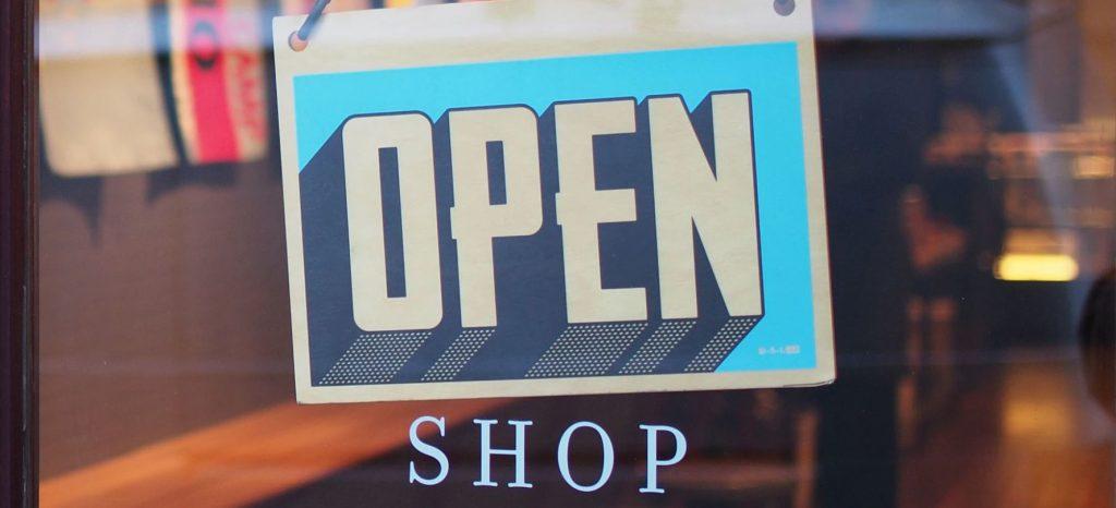 shopping open sign on door