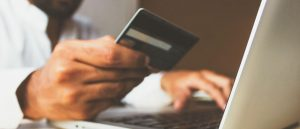 man holding credit card online shopping