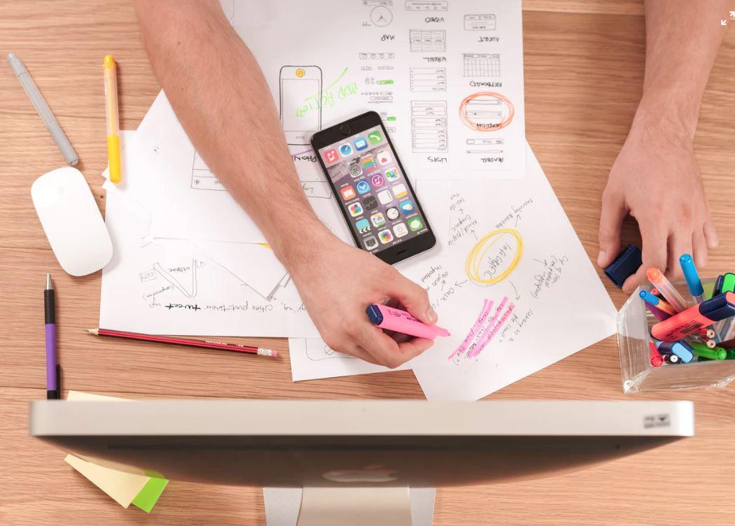 Man drawing marketing plan on paper