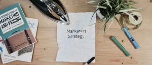 desk with marketing strategy written on paper